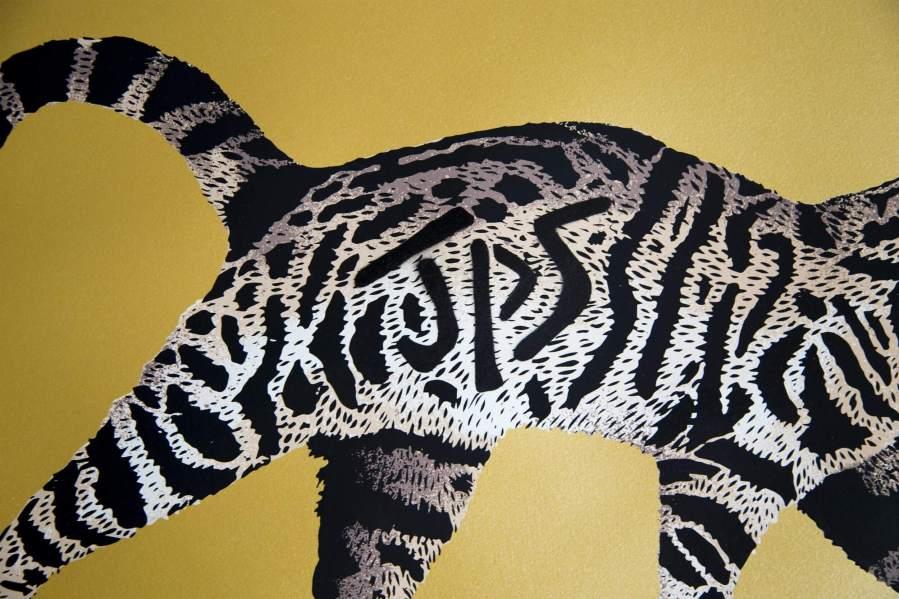 JPS Tag Cat Gold Print Close up shot 1