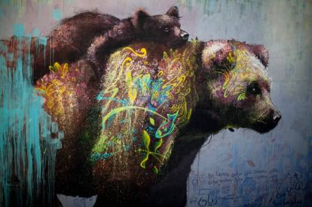 Ernesto Maranje, Bear with cub street art mural, Iraq 2017. Photo credit aptART