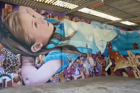 BKfoxx and Zeso, Alice in Wonderland Street Art Mural series 2 ' Day Dreaming' 2017. Photo Credit Virginie Favard