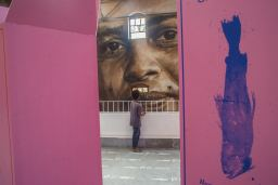 start-street-art-festival-mumbai-india-Sameer-Kulavoor-Parfum-Sassoon-Showroom-image-in-the-fore-and-Guido-Van-Helten-mural-in-the-background-pc-Akshat-Nauriyal-2