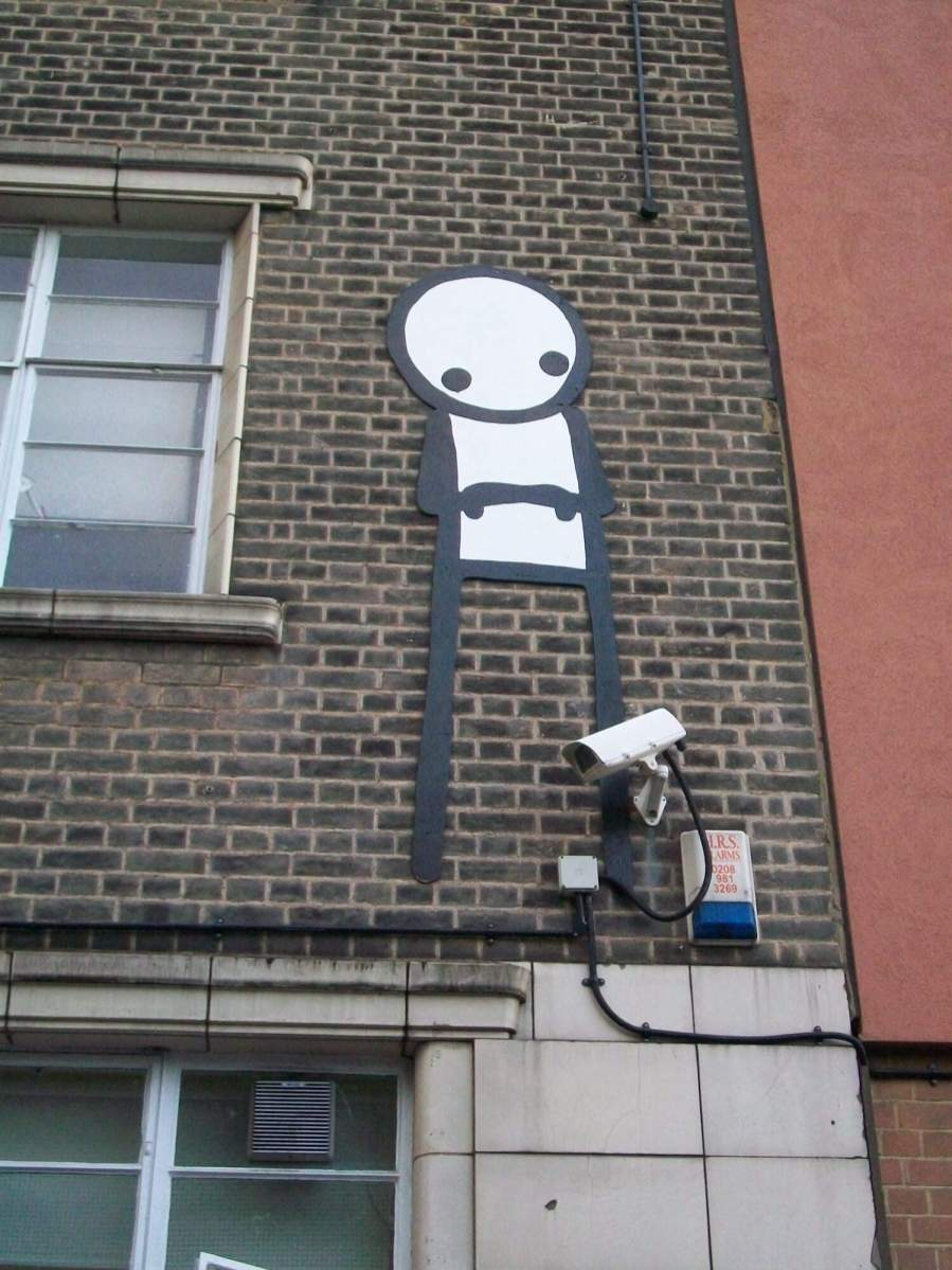 """Stik, Wooden Stik Sculpture """"Up on the Roof"""" to be auctioned off at Christies Auction House for Cardboard Citizens Charity 2018. Photo Credit Stik"""