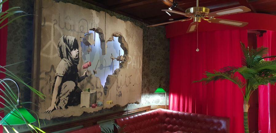 Banksy artwork, The Walled Off Hotel, West Bank, Bethlehem, Palestine 2019.