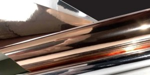 Rolls and sheets of metallized polyester film