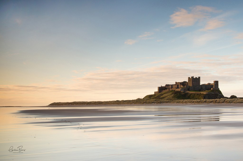 Footsteps on Bamburgh Castle beach