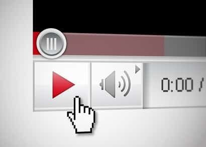 Finger poised on video play button