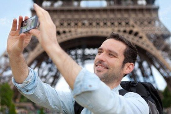 View of Young attractive tourist taking selfie in Paris