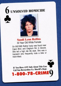 Sand Lynn Rollins' body was found in 1995 in a rural area.  The card indicates that she was a transient.  It appears that the photo used may have been a booking photo where she herself was arrested.  Murder victims come from all sorts of different backgrounds, and it is the responsibility of police departments to assure that all cases are given a top priority.