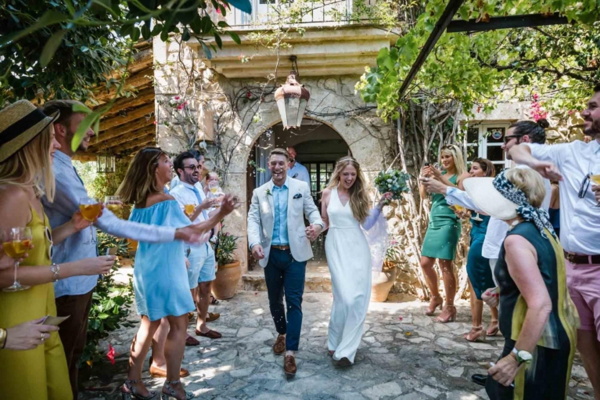 Cathy and Ben do their confetti walk during their beautiful Mallorca finca wedding.