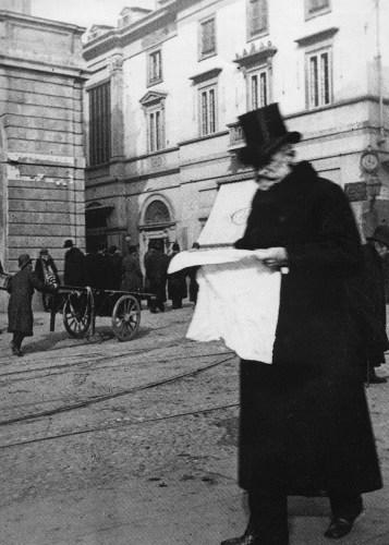 Giuseppe Verdi reading the newspaper near La Scala