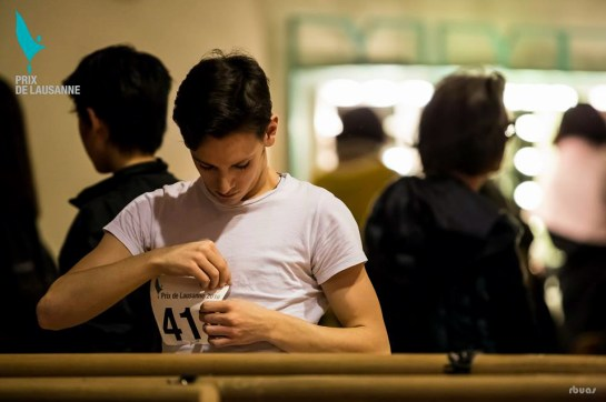 Vincenzo pinning on his number at the Prix de Lausanne