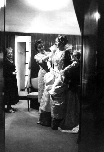 Maria Callas in her dressing room at La Scala preparing for Ifigenia in Tauride, with Giovanna Lomazzi, 1957