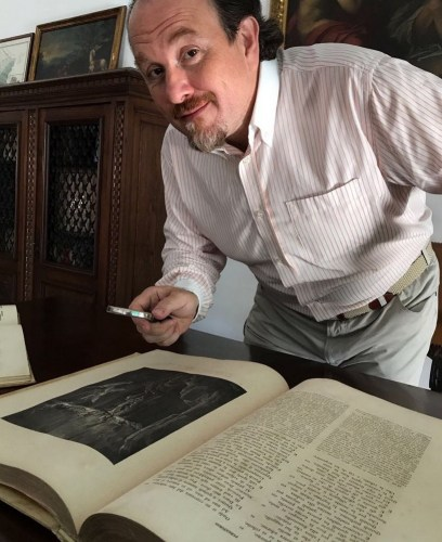 Franco Vassallo with one of his many antique copies of The Divine Comedy