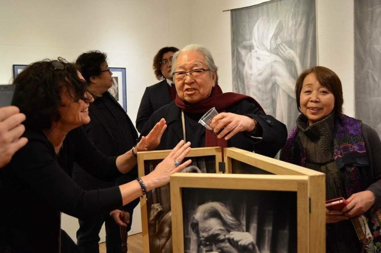 Eikoh Hosoe threatens to pour wine over Barbara Luisi's Triptych at the Roonee 247 Fine Arts Gallery in Japan