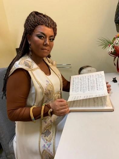 Hui He in the dressing room before Aida