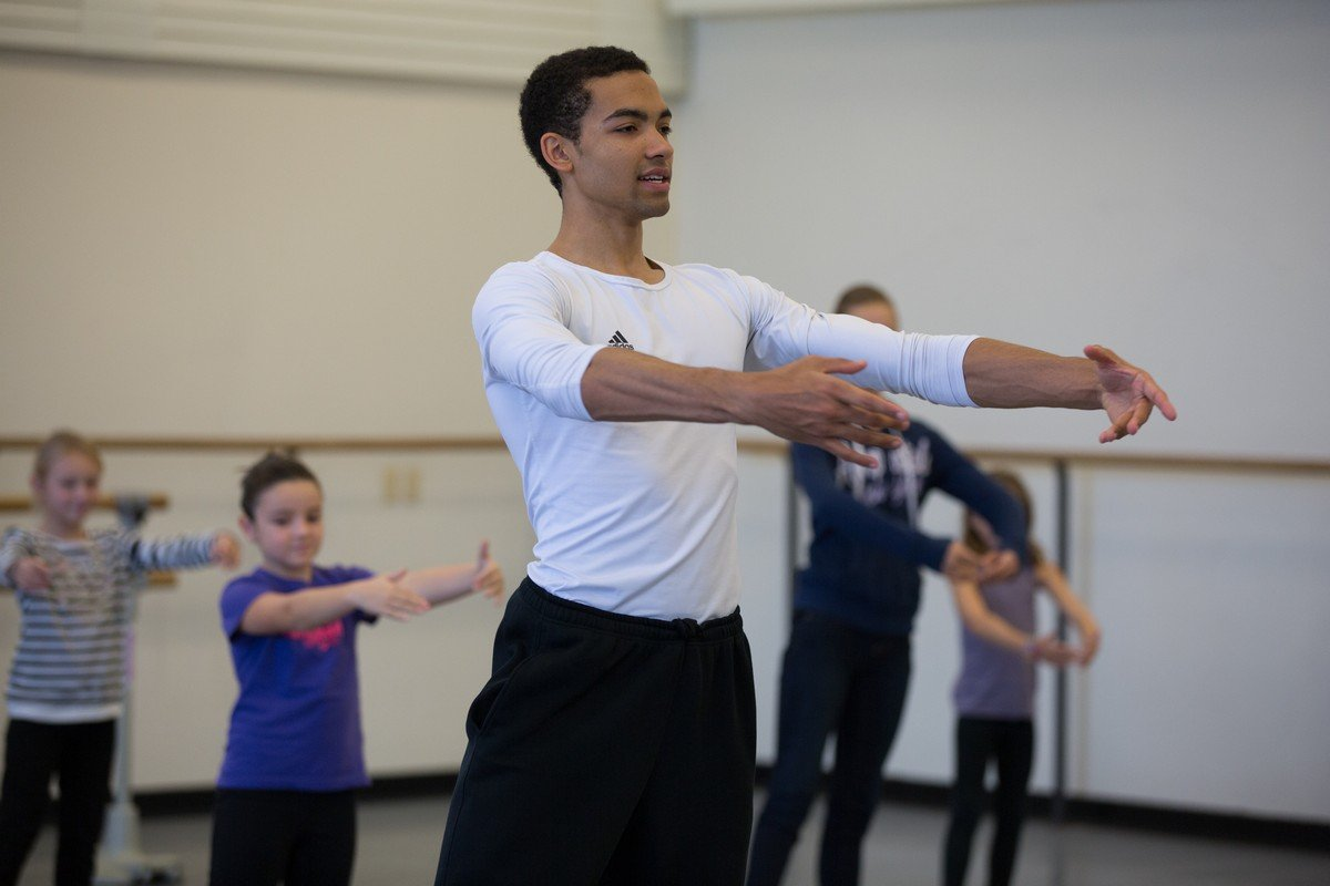 Ballet Break, NYCB dancer Silas Farley leading a workshop for children, photo by Rosalie O'Connor.