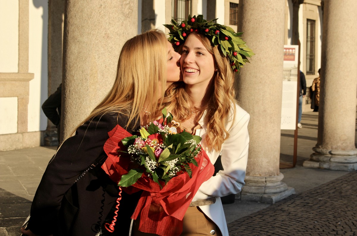 Virna celebrating her law degree with her sister
