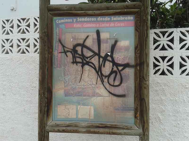 Cartel con graffiti