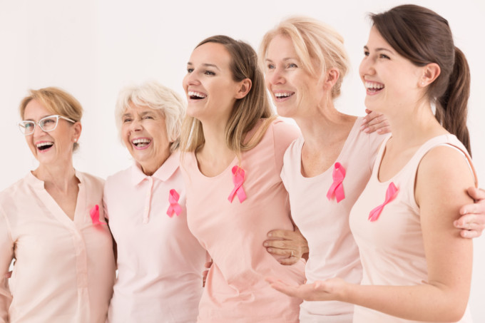 66120879 - happy breast cancer survivors supporting each other