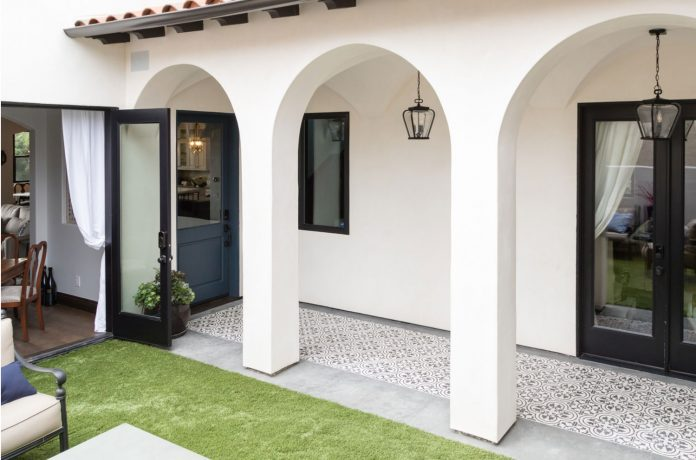 patio with black and white cement tiles