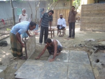 Constructing the concrete floor of the $100Kitchen.