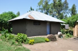 A typical funnel-shaped rural house in Kenya has open eaves, which allows for easy entry of mosquitoes potentially transmitting malaria. Photo credit: Atieli et al, 2012