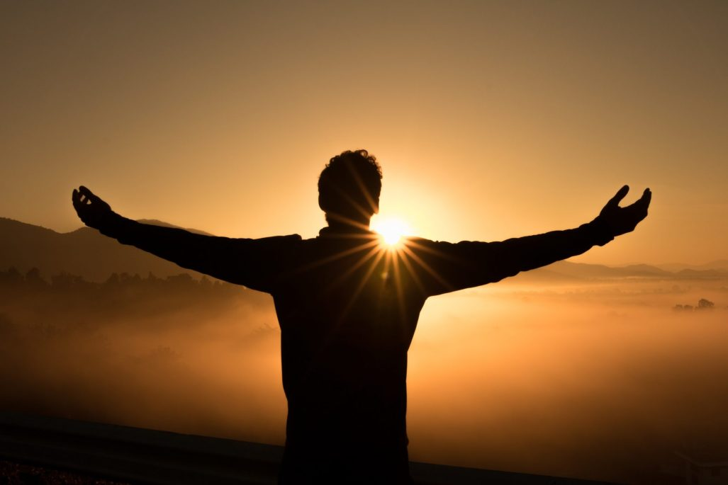 A Man holding his hands up towards the sun in gratefulness #think happy #live happy #positive mindset