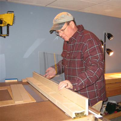 Ron now works with the optical quality acrylic on the bending jig, creating the cover to fit the oak base.