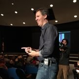 Jeff Kinney circulating through the audience taking student questions.
