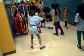 Photo of students hula-hooping in hallway