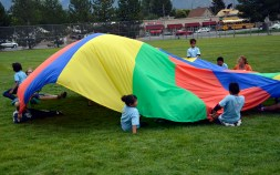 Photo of students playing with parachute