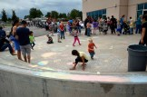 Photo of students drawing with sidewalk chalk