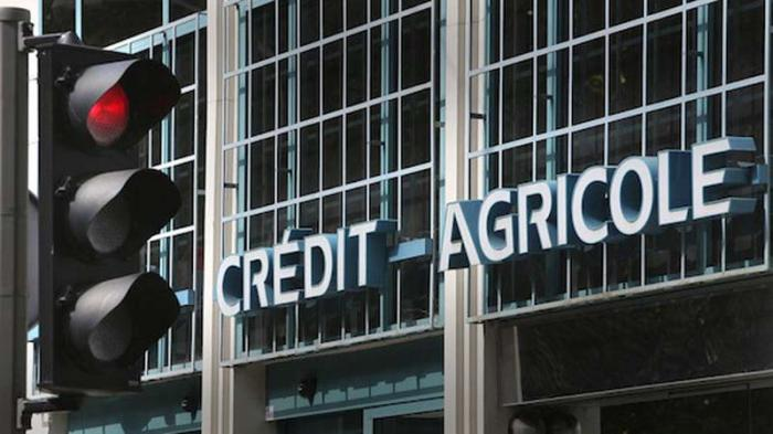 Sign of Credit Agricole Bank, is seen in Nice, southeastern France, Wednesday, Sept. 14, 2011. Moody's on Wednesday downgraded the credit ratings of French banks Societe Generale and Credit Agricole following a period of huge volatility in the markets as investors fretted about their potential exposure to the debts of Greece. (AP Photo/Lionel Cironneau )