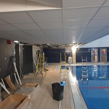 A waterproof ceiling tile and grid