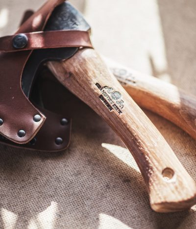 axes stacked with sheaths on in sunlight