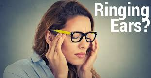 ringing ears text displayed next a woman having a headache