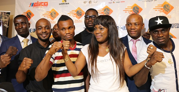 CEO of Upscale Entertainment, Roni Yeboah with the boxers and promoters.