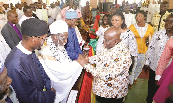 President Akufo-Addo shaking hands with Sheikh Nuhu Osman Sharabutu (2nd left), Chief Imam, at the ceremony.  Picture: SAMUEL TEI ADANO