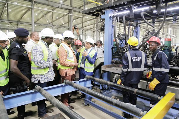 Mr Mukesh Thakwani (right), Chief Executive Officer (CEO), B5 Plus Limited, explaining the process of steel manufacturing to Mr Alan Kyerematen (2nd right), Minister of Trade and Industry, and Mr Robert Ahomka-Lindsey, a Deputy Minister of Trade and Industry, during the tour of the factory