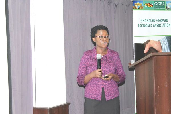 Mrs Evelyn A. E. Nyarko (inset), Deputy Director  of Investor Services Division, GIPC, addressing participants in the forum.  Picture: PATRICK DICKSON