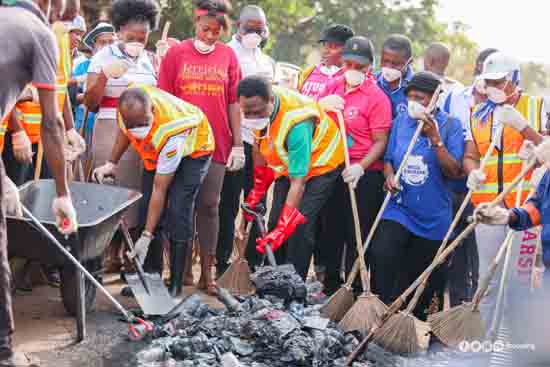 Apostle Eric Kwabena Nyamekye (3rd left with a shovel) and some members of the church during the sanitation campaign to rid the country of filth