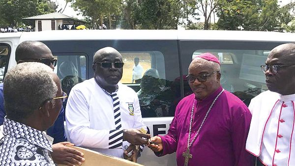 Mr Ernest Bediako Sampong (second left) presenting the keys of the vehicle to the Chairman of the Board of Governors of Adisadel College and the Anglican Bishop of Cape Coast, Rt.Rev. Reginald Atta- Baffoe. INSET: The vehicle donated by Ernest Chemists Limited