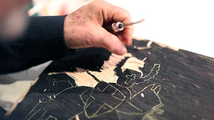 Seymour-Chwast-working-on-a-woodcut-illustration