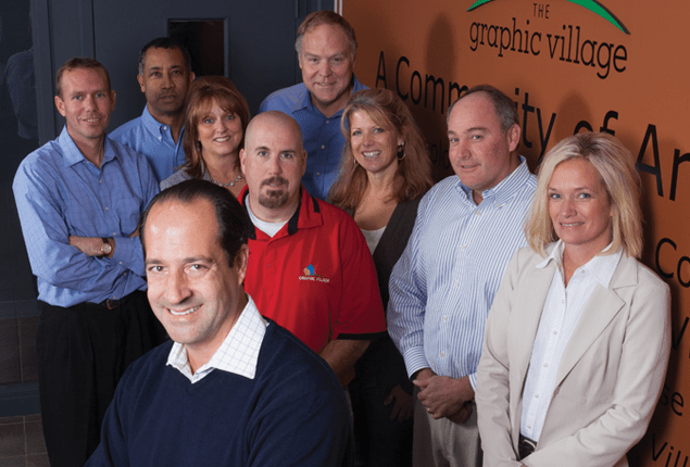 The executive leadership at Graphic Village