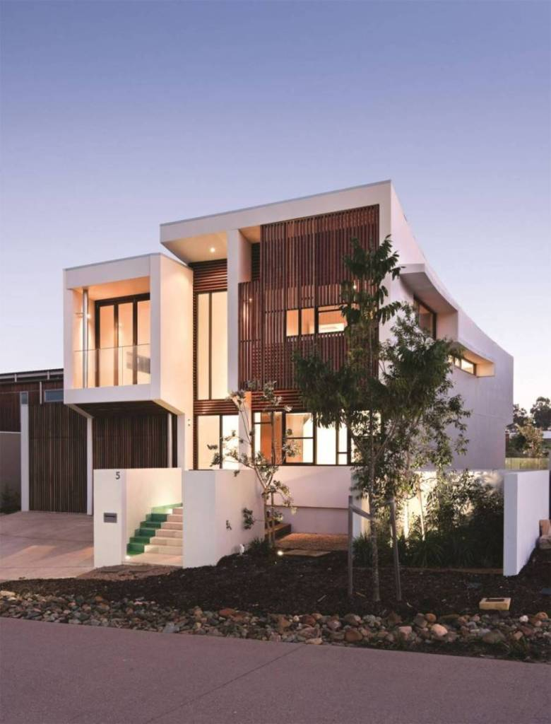 Facade home with white colour exterior and look stairs also great light