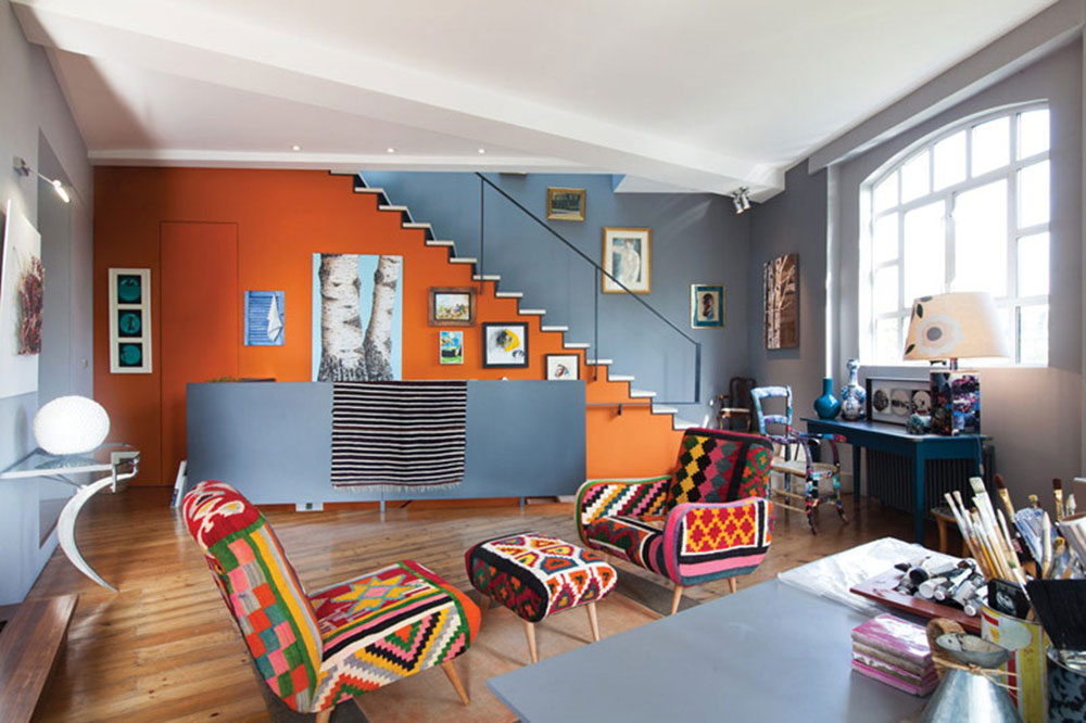 Interior design with stairs and wall art and unique color chairs
