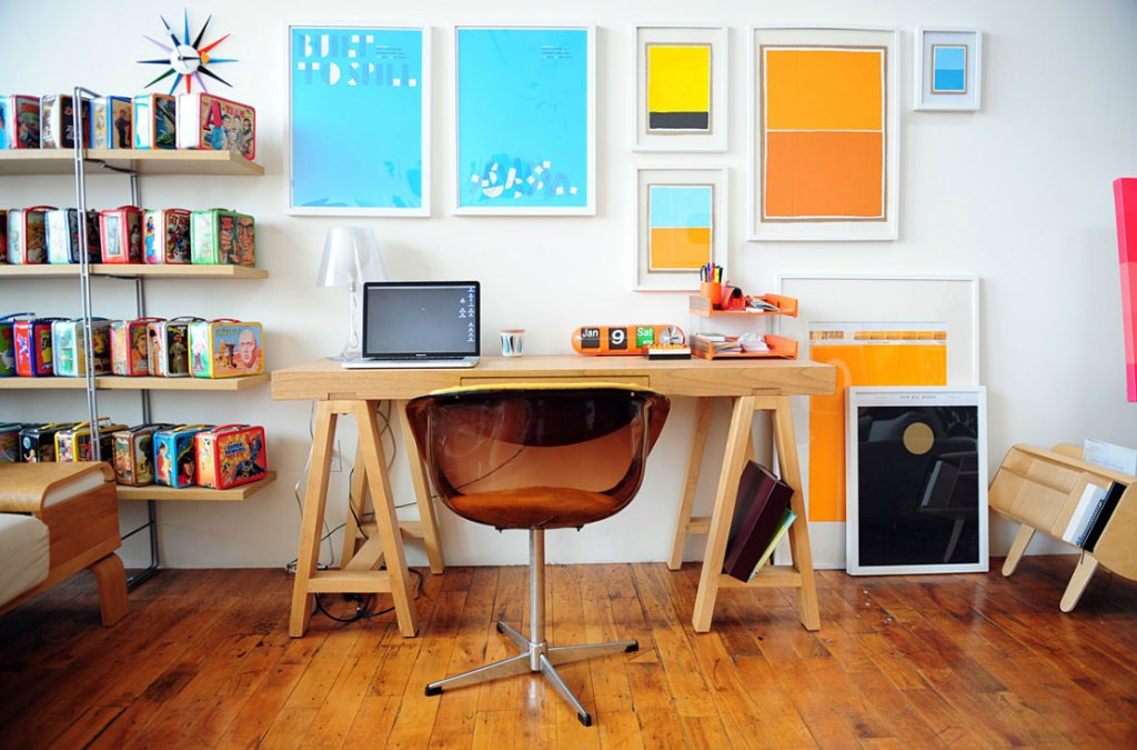 boy home office with wooden desk and wall art decor also simple shelving