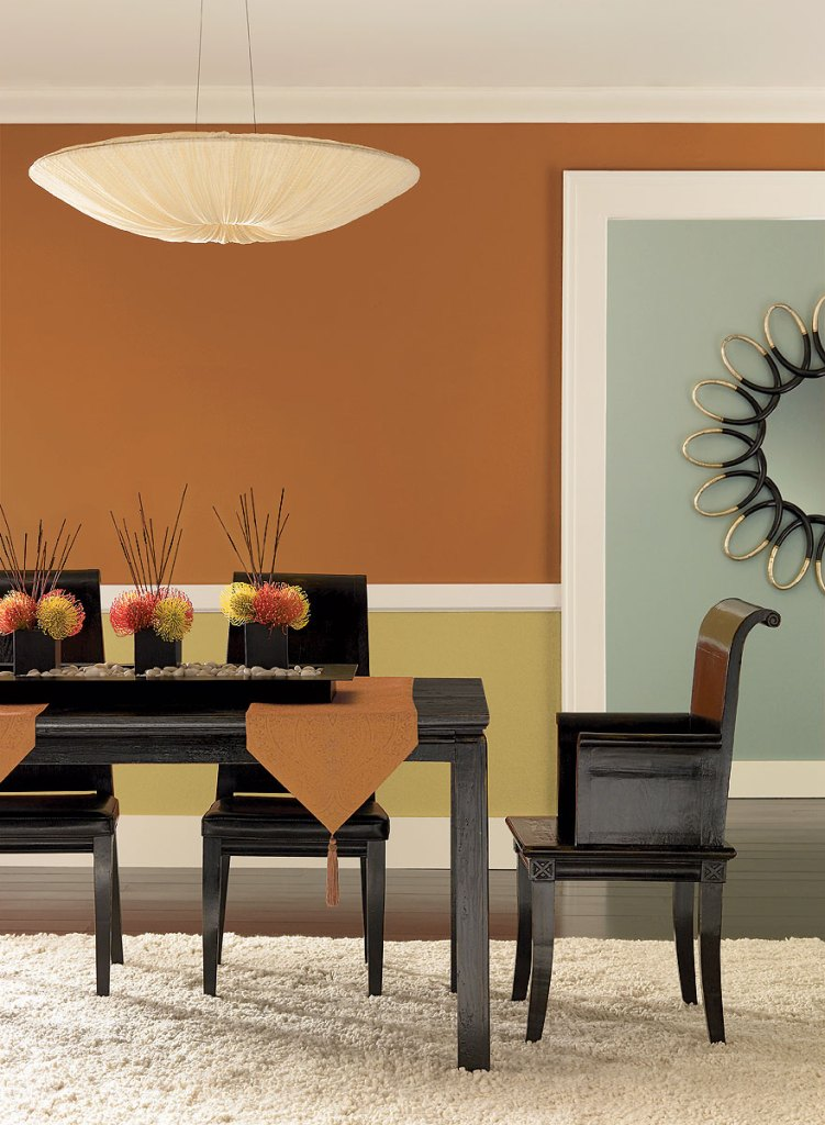 dining room with wall colors contrast and dark dining chairs also good rug