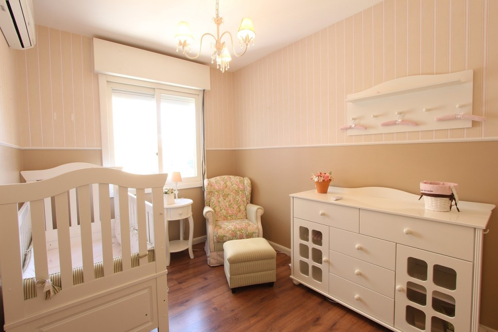 baby room with chandelier and chair also furniture