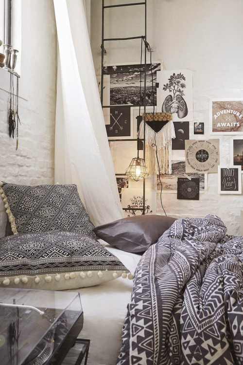 bohemian bedroom with brick wall and wall art