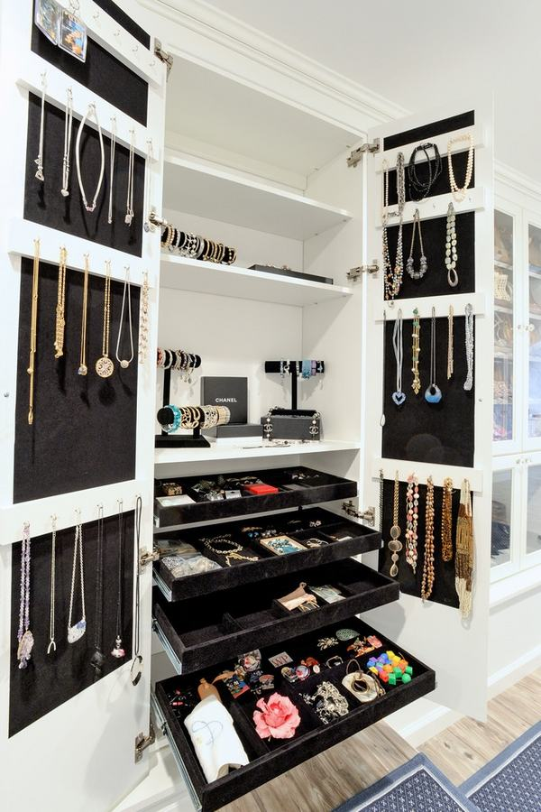 luxury walk in closet design jewelry organizers and wooden flooring view